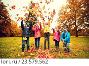Купить «happy children playing with autumn leaves in park», фото № 23579562, снято 10 октября 2015 г. (c) Syda Productions / Фотобанк Лори