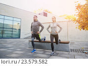 Купить «couple doing lunge exercise on city street», фото № 23579582, снято 17 октября 2015 г. (c) Syda Productions / Фотобанк Лори