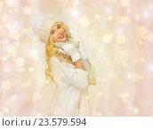 Купить «beautiful woman in winter hat, scarf and mittens», фото № 23579594, снято 7 октября 2012 г. (c) Syda Productions / Фотобанк Лори