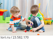 Купить «little children playing with toys», фото № 23582170, снято 12 декабря 2014 г. (c) Оксана Кузьмина / Фотобанк Лори