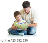 Купить «kid boy and his dad read a book», фото № 23582530, снято 6 ноября 2014 г. (c) Оксана Кузьмина / Фотобанк Лори