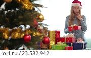 Купить «girl in Santa hat with Christmas gifts», видеоролик № 23582942, снято 11 февраля 2016 г. (c) Яков Филимонов / Фотобанк Лори