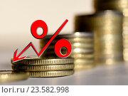 Купить «Красный знак процента на фоне денег», фото № 23582998, снято 24 апреля 2016 г. (c) Сергеев Валерий / Фотобанк Лори
