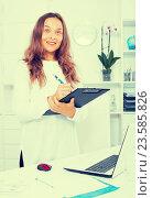 Купить «young woman employee in office», фото № 23585826, снято 26 июня 2019 г. (c) Яков Филимонов / Фотобанк Лори