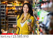 Купить «Woman shopping for groceries», фото № 23585910, снято 9 мая 2016 г. (c) Wavebreak Media / Фотобанк Лори