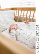 Купить «Baby boy relaxing on a cradle», фото № 23587754, снято 22 января 2016 г. (c) Wavebreak Media / Фотобанк Лори