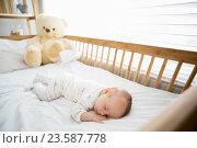 Купить «Baby boy sleeping on a cradle», фото № 23587778, снято 22 января 2016 г. (c) Wavebreak Media / Фотобанк Лори