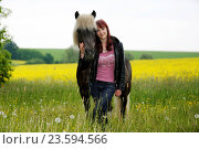 Купить «woman and Icelandic horse», фото № 23594566, снято 13 января 2016 г. (c) age Fotostock / Фотобанк Лори
