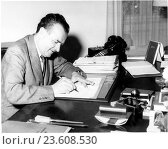 The President of the Czechoslovak Republic, Klement Gottwald, signing new laws concerning the churches in Czechoslovakia, 1953. Редакционное фото, фотограф Sovfoto \ UIG / age Fotostock / Фотобанк Лори