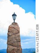Купить «Фонарь на каменном столбе на фоне неба», фото № 23611038, снято 7 июля 2016 г. (c) Иван Карпов / Фотобанк Лори
