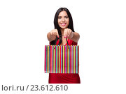Купить «Woman in red dres after shopping isolated on white», фото № 23612610, снято 28 июля 2016 г. (c) Elnur / Фотобанк Лори