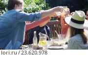 Купить «happy friends having dinner at summer country site», видеоролик № 23620978, снято 5 сентября 2016 г. (c) Syda Productions / Фотобанк Лори