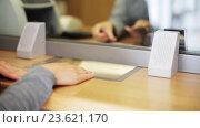 Купить «clerk counting money and customer at bank office», видеоролик № 23621170, снято 19 сентября 2016 г. (c) Syda Productions / Фотобанк Лори