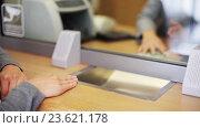Купить «clerk counting money and customer at bank office», видеоролик № 23621178, снято 19 сентября 2016 г. (c) Syda Productions / Фотобанк Лори