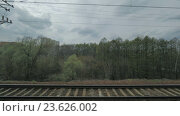 Купить «View from the window of a moving train seen trees, buildings, bridges and railroad», видеоролик № 23626002, снято 22 сентября 2016 г. (c) Данил Руденко / Фотобанк Лори