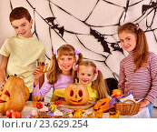 Купить «Halloween party with children eating trick or treat food.», фото № 23629254, снято 26 сентября 2012 г. (c) Gennadiy Poznyakov / Фотобанк Лори