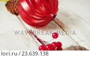 Купить «Pine cone, cherries and jingle bell arranged on a plank», видеоролик № 23639138, снято 2 июля 2020 г. (c) Wavebreak Media / Фотобанк Лори