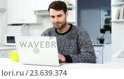 Купить «Man using laptop», видеоролик № 23639374, снято 18 июля 2019 г. (c) Wavebreak Media / Фотобанк Лори