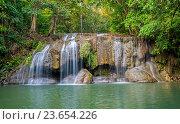 Купить «Пейзаж с проточной бирюзовой водой водопада  Erawan в глубине тропического леса. Национальный парк в Канчанабури, Таиланд», фото № 23654226, снято 30 марта 2015 г. (c) Тупиков Максим Борисович / Фотобанк Лори