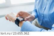 Купить «close up of hands with incoming call on smartwatch», фото № 23655362, снято 13 августа 2015 г. (c) Syda Productions / Фотобанк Лори