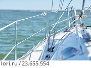 Купить «close up of sailboat or sailing yacht deck in sea», фото № 23655554, снято 18 августа 2015 г. (c) Syda Productions / Фотобанк Лори