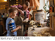 Купить «father and son with drill working at workshop», фото № 23655586, снято 14 мая 2016 г. (c) Syda Productions / Фотобанк Лори