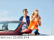 Купить «friends driving in car and blowing bubbles», фото № 23655614, снято 28 мая 2016 г. (c) Syda Productions / Фотобанк Лори