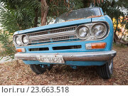 Купить «Close up front view of blue Datsun 1300 pickup», фото № 23663518, снято 16 августа 2016 г. (c) EugeneSergeev / Фотобанк Лори