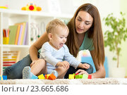 Купить «cute mother and kid boy playing together indoor», фото № 23665686, снято 6 октября 2014 г. (c) Оксана Кузьмина / Фотобанк Лори