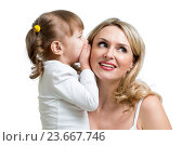 Купить «kid sharing a secret with mother», фото № 23667746, снято 3 февраля 2014 г. (c) Оксана Кузьмина / Фотобанк Лори