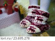 Купить «Носочки с оленями», фото № 23695278, снято 20 декабря 2015 г. (c) hommik / Фотобанк Лори
