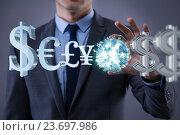 Купить «Businessman with various currencies in business concept», фото № 23697986, снято 20 сентября 2019 г. (c) Elnur / Фотобанк Лори