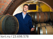 Купить «portrait of young male wine maker in coat working in winery cellaryoung wine maker in cellarman, male, young, working, winery, wine, cellar, wood, aging, standing, looking, expert, manufactory, uniform, bottler, equipment, section, alcohol, beverage, winemaking, professional, occupation, small, tank, processing, barrel, compartment, container, positive, european, caucasian, 20s, 30-35, portrait, examining, cheerful, glad, production, taste, factory, employed, showing, visiting, coveralls, unit, one, promoting, checking, coat, quality, control, craft, man, male, young,working, winery, wine, standing, cellar, wood, aging, looking, expert, manufactory, uniform, bottler, equipment, section, alcohol, bottle, beverage, winemaking, professional, occupation, processing, barrel, compartment, container, positive, caucasian, american, 30s, 25-29, expertise, smiling, producer, one, segment, label, selective, check-up, attentive, leaning,», фото № 23698578, снято 12 декабря 2017 г. (c) Яков Филимонов / Фотобанк Лори
