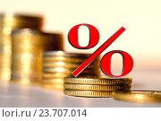 Купить «Красный знак процента на фоне денег», фото № 23707014, снято 12 февраля 2016 г. (c) Сергеев Валерий / Фотобанк Лори