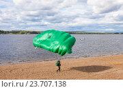 Купить «Parachute jumper on a  wing parachute execute a controlled descent by parachute on a beach», фото № 23707138, снято 11 сентября 2016 г. (c) FotograFF / Фотобанк Лори