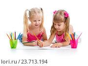Купить «two girls drawing with color pencils together over white background», фото № 23713194, снято 13 октября 2013 г. (c) Оксана Кузьмина / Фотобанк Лори