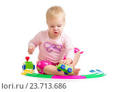 Купить «child playing with toy», фото № 23713686, снято 18 октября 2012 г. (c) Оксана Кузьмина / Фотобанк Лори