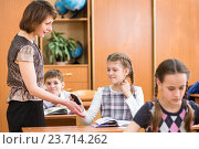 Купить «Teacher confiscating schoolkid's mobile phone at lesson», фото № 23714262, снято 11 мая 2013 г. (c) Оксана Кузьмина / Фотобанк Лори
