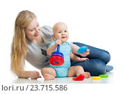Купить «baby boy and mother playing together», фото № 23715586, снято 17 декабря 2012 г. (c) Оксана Кузьмина / Фотобанк Лори