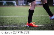 Купить «soccer player playing with ball on field», видеоролик № 23716758, снято 25 сентября 2016 г. (c) Syda Productions / Фотобанк Лори