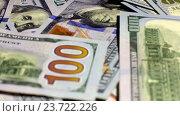 Купить «Стодолларовые купюры крупным планом», видеоролик № 23722226, снято 29 сентября 2016 г. (c) Pavel Biryukov / Фотобанк Лори