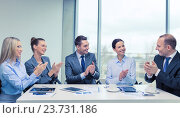 Купить «business team with laptop clapping hands», фото № 23731186, снято 9 ноября 2013 г. (c) Syda Productions / Фотобанк Лори