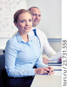 Купить «smiling business people meeting in office», фото № 23731558, снято 25 октября 2014 г. (c) Syda Productions / Фотобанк Лори
