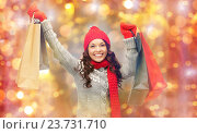 Купить «happy woman in winter clothes with shopping bags», фото № 23731710, снято 30 октября 2011 г. (c) Syda Productions / Фотобанк Лори