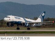 """Самолет авиакомпании """"Аврора"""" в аэропорту Владивосток. Редакционное фото, фотограф Антон Афанасьев / Фотобанк Лори"""