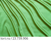Купить «green satin or silk fabric background», фото № 23739906, снято 18 августа 2012 г. (c) Оксана Кузьмина / Фотобанк Лори