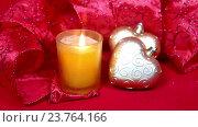 Купить «Новогодние украшения и горящая свеча на красном фоне», видеоролик № 23764166, снято 12 октября 2009 г. (c) Куликов Константин / Фотобанк Лори