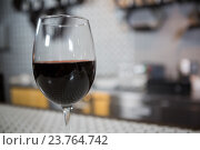 Купить «Glass of red wine on counter», фото № 23764742, снято 30 июня 2016 г. (c) Wavebreak Media / Фотобанк Лори