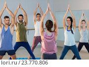 Купить «Instructor taking yoga class», фото № 23770806, снято 28 апреля 2016 г. (c) Wavebreak Media / Фотобанк Лори