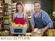 Купить «Portrait of staff working at bakery counter», фото № 23771018, снято 17 мая 2016 г. (c) Wavebreak Media / Фотобанк Лори